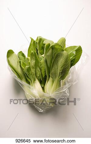 stock image of several baby pak choi in plastic bag 926645 search stock photos mural pictures. Black Bedroom Furniture Sets. Home Design Ideas