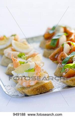 Pictures of canap s with prawn egg tomato mozzarella on for Mozzarella canape