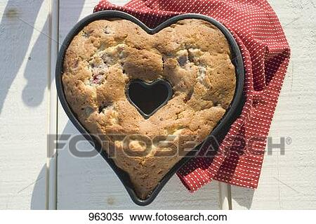 Heart Shaped Cake Tins : Stock Image of Heart-shaped cake in the baking tin ...