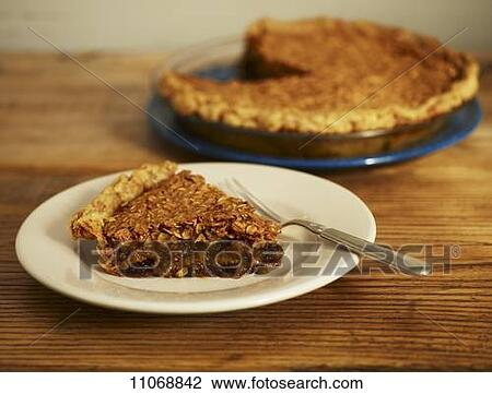 Stock Photo of Slice of Chocolate Oatmeal Pie on a Plate; Whole Pie in ...