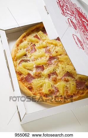 Stock Photo of Hawaiian pizza with ham and pineapple in ...