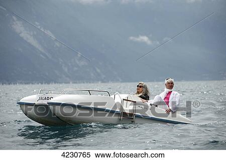 Stock Image of Senior couple with pedal boat in mountain ...