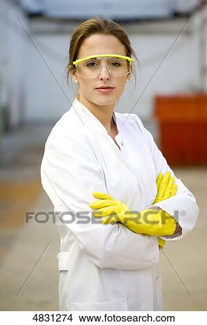 Stock Photo Of Young Woman With Lab Coat And Protective