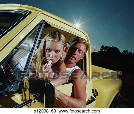 Stock Photography Of Teenage Girl Leaning Over Young Man