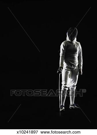 Picture of Young woman wearing full fencing outfit ...