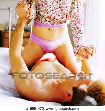 Man sits on womans face