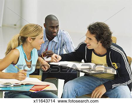stock photo of three students talking to each other in a
