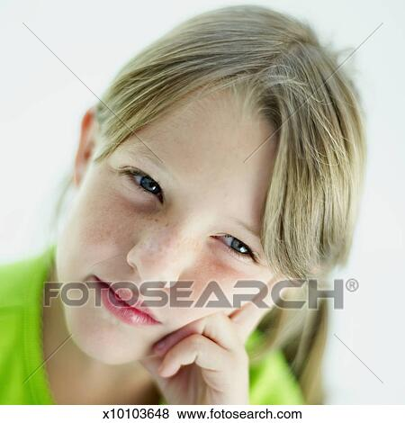 Pictures Of Close Up Of A Girl Resting Her Face On Her
