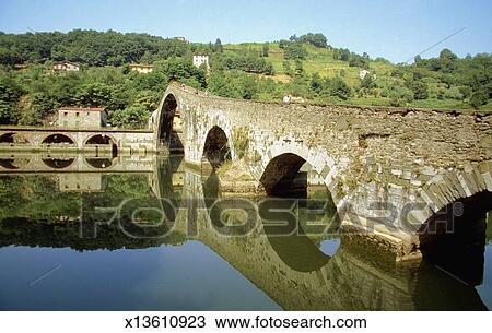 Stock Photo of Devil\'s Bridge over a canal, Bagni di Lucca, Tuscany ...
