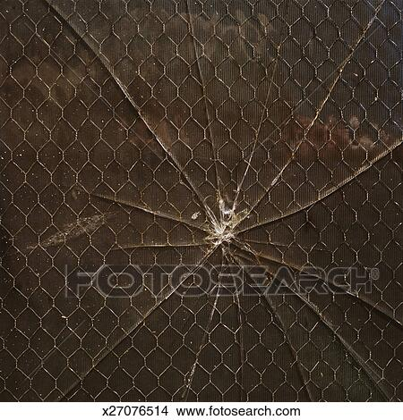 Stock photo of broken window chain link and cardboard for Broken glass mural