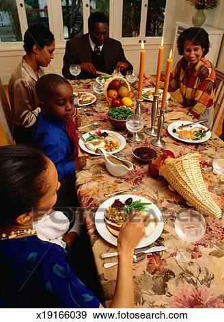 Stock Photograph Of Family Eating Thanksgiving Dinner X19166039