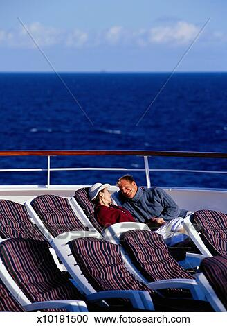 Stock Photography Of Couple Sitting In Cruise Ship Deck