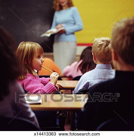 Stock Photo Of Children 6 8 Sitting At Desks In