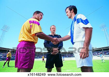 Two Footballers Shaking Hands