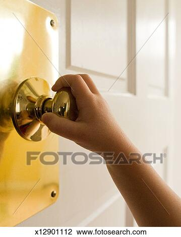 Stock Photo of childs hand on a door knob x12901112 - Search Stock ...