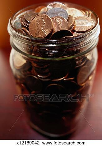 Stock Photo Of Pennies In A Jar X12189042 Search Stock