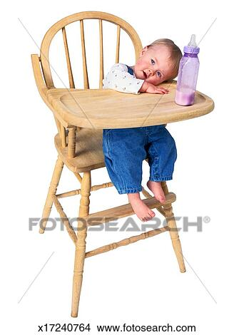 Stock photo of toddler sitting in a high chair x17240764 for Toddler sitting chair