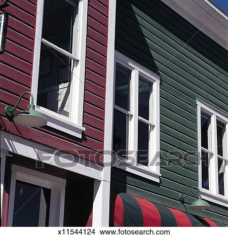 Stock Photo of a red-violet house with white trim stands ...