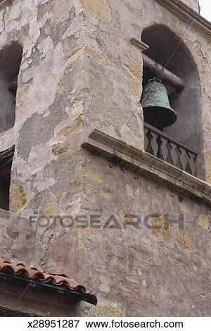 Picture of an old stone stucco mexican mission style bell for Mission stucco