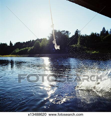 Stock photography of rope swing over water water for Swing over water