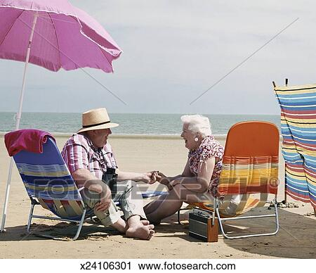 Stock Photography Of Elderly Couple Sitting On Deck Chairs