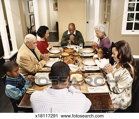 Stock Photography of Three Generational Family Sit Round ...