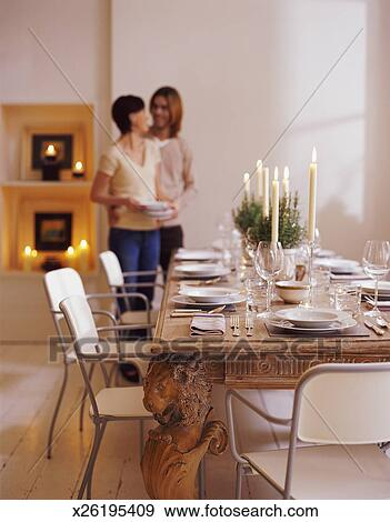 Stock Photograph Of Couple Standing In A Dining Room Next