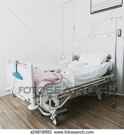Stock Photo of Empty Hospital Bed x24818993 - Search Stock ...