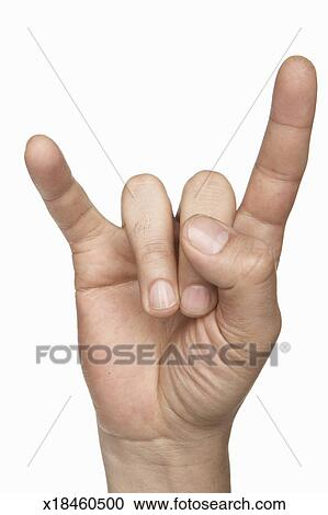 Stock Photography of Man making 'devil horn' sign (focus on hand ...