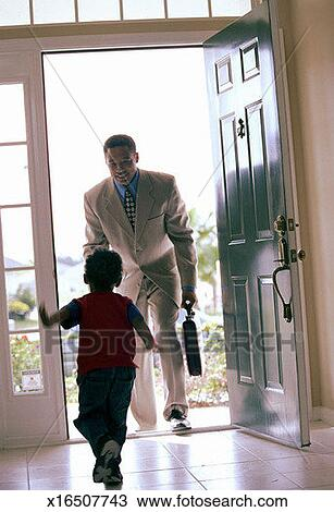 Stock Photo Of Little Boy Greets Father Coming Home From