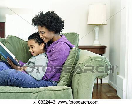 Stock Photo Of Mother And Son 6 8 Sitting On Sofa