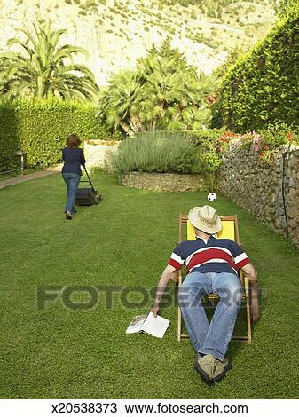 Stock Photo Of Mature Man Relaxing In Deckchair In Garden