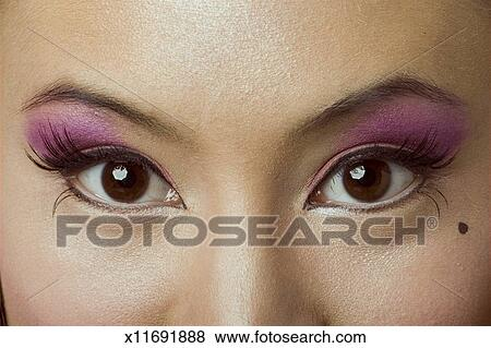 Pictures Of Young Woman With Brown Eyes Wearing False