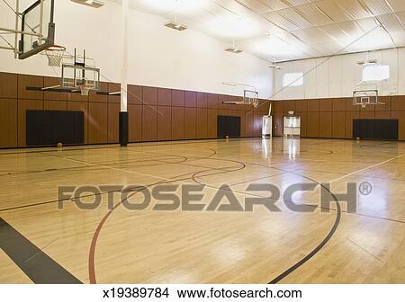 Stock Photo - Empty indoor basketball court  Fotosearch - Search Stock    Empty Indoor Basketball Court