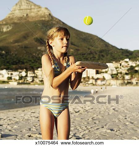 stock photo of portrait of a young girl 8 10 playing