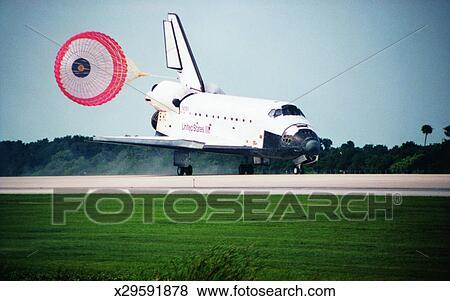 during a space shuttle landing a parachute deploys - photo #11