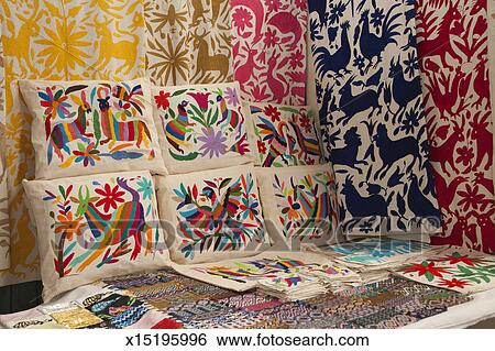 Embroidered textiles in Mexican market