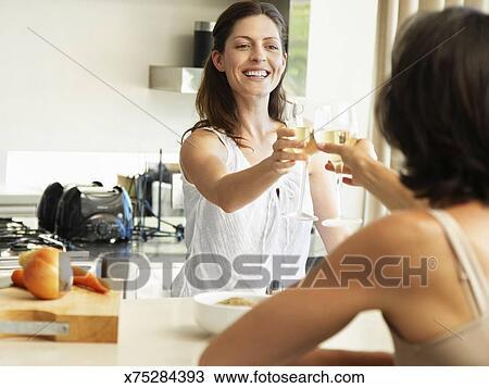 stock foto zwei sch ne frauen in ihr vierziger toasten x75284393 suche stock. Black Bedroom Furniture Sets. Home Design Ideas