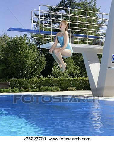 Stock Photography Of Girl 12 13 Performing Cannonball Jump Into Swimming Pool X75227720