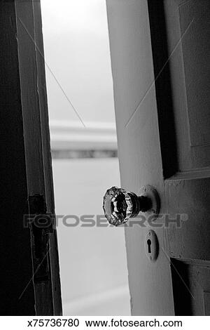 Stock Photography Of View Inside Empty Closet Through Cracked Door