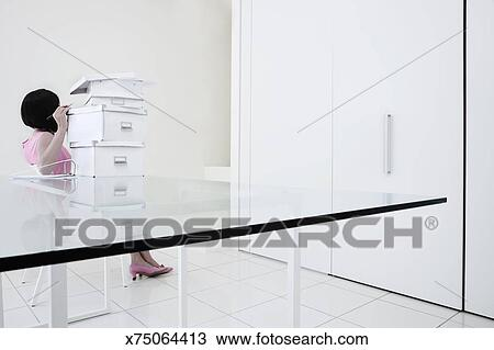stock photo woman in modern office with a stack of box files fotosearch boxes stack office file
