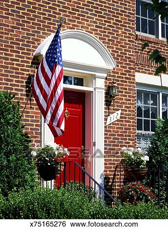 Stock Images Of American Flag Hanging Alongside Front Door
