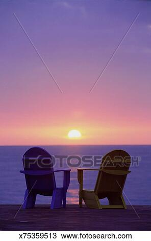 Stock Photo of Two beach chairs silhouette sunset x75359513