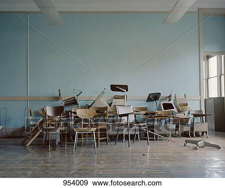 Old Broken Chairs In An Abandoned School