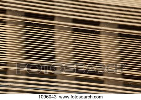 Stock Photo Of Louvered Wooden Slats In Front Of Window