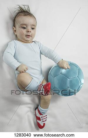 Stock Photography Of A Baby Boy Wearing Baby Soccer Shoes