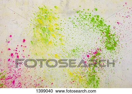 Stock Photography of Powder paints spread on white wall during Holi ...