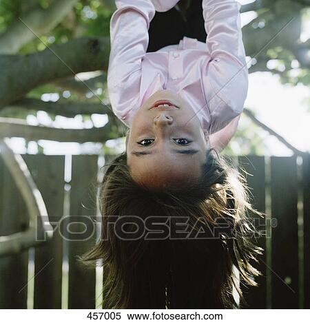 Girl Hanging Upside Down From a Tree Girl Hanging Upside Down From
