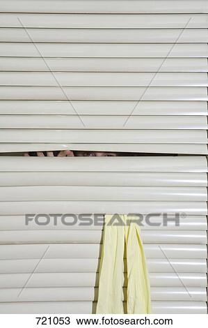 Stock Photo Of A Person Peeking Through Window Blinds