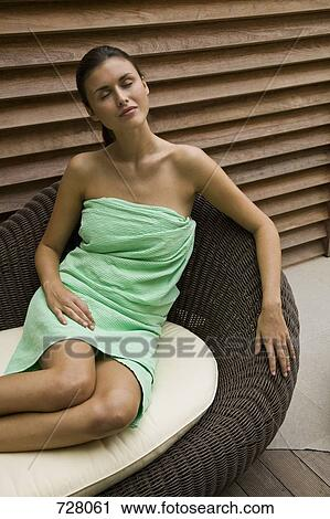 Stock Photography Of A Woman Reclining In A Chaise Lounge